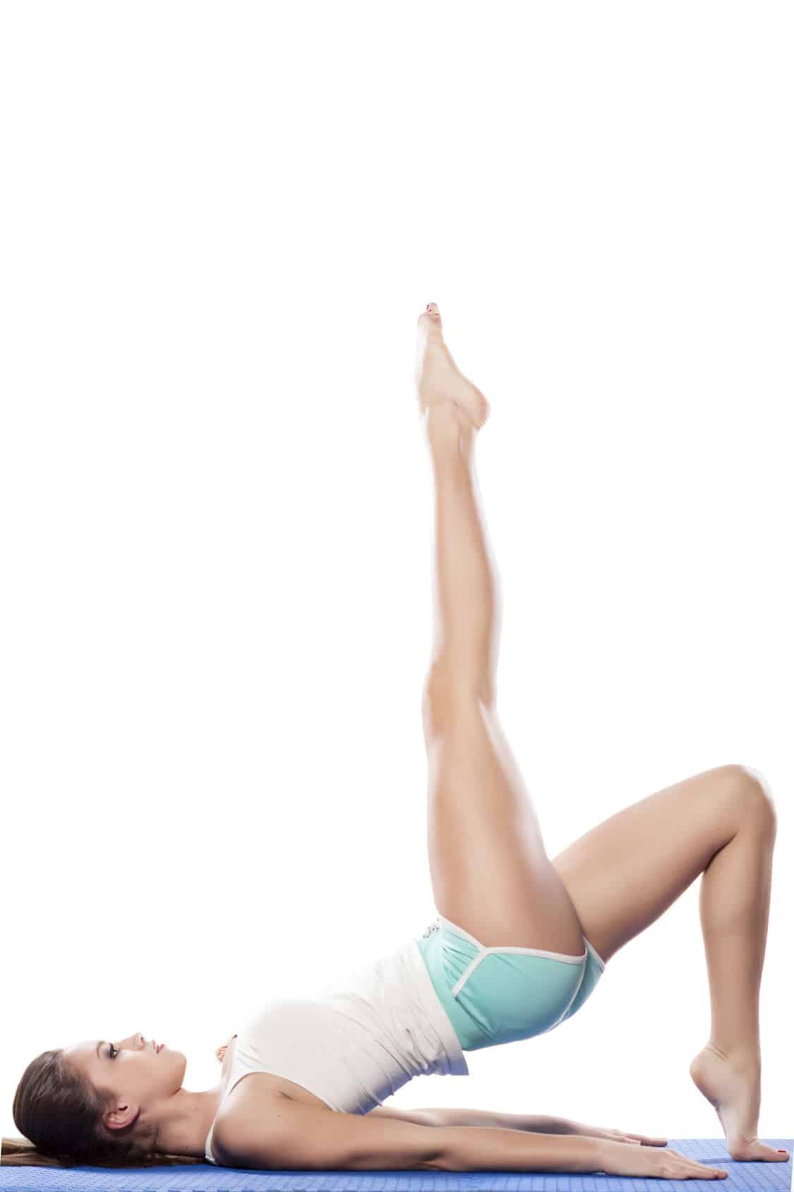 Young beautiful woman doing aerobics exercises